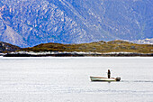 An Inuit, Eskimo on the hunt for seals, at Nuuks coast, Greenland.