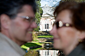 Mature adult couple smiling at each other, Benrath castle, Düsseldorf, state capital of NRW, North-Rhine-Westphalia, Germany