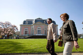 old couple passing by, holding hands, castle of Benrath, world heritage of UNESCO, sightseeing spot, local recreation area, Düsseldorf, state capital of NRW, North-Rhine-Westphalia, Germany