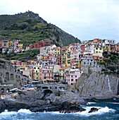 view on Manarola, Cinque Terre, Italy, coast, sea, harbour, gulf of genua, overview, coloured houses, italien city, ancient, fisherman village, typical townscape, world heritage of UNESCO, travel, journey, culture