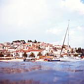 promenade of hvar, croatia, dalmatia, adriatic sea, coast, water, old houses, ancient, anchored ships, harbor, sightseeing, travel, vacation, holiday, trip, island, tourism, beautiful weather, sunshine, summer, shore leave, moorage, moorings, sailing, sai