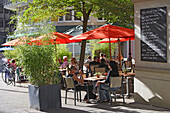 People sitting under sunshades of a Bistro in pedestrian area, Rue de la Poste, Luxembourg, Luxembourg, Europe