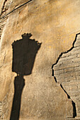 shadow of street lamp on old wall, Valencia, Spain