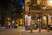 Sant Jaume, outdoor Cafe with young people sitting on a Square, old town, Barrio del Carmen evening, Valencia, Spain