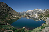 Mirroring of mountains on water surface of a lake, Great St Bernard Pass, Canton of Valais, Switzerland