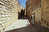 Young adult walking along the Jewish quarter, Jerusalem, Israel