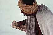 An Arab reading a book, Asia