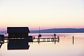 Boathouse in twilight, Lake Starnberg, Bavaria, Germany