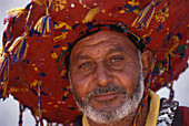 Local man selling water, Agadir, Marocco, Africa