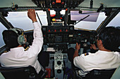 Pilot and Copilot on a Merpati Airplane, Molukken, Indonesia