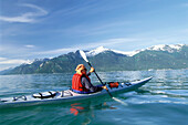 Person in a kayak at Chilkoot Inlet near Haines, Alaska, USA