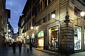Steet with shops and restaurants, leaving from Piazza San Lorenzo, Florence, Tuscany, Italy