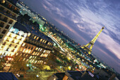 Panorama, Cityscape of Paris at night, with Eiffel tower in the background, illuminated, Capitel, Paris, France