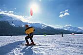 A man snowkiting at Lake Sils, Winter sport, Engadin, Switzerland