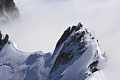 View from Dent du Geant to mountaineers on the Rochefort ridge, Mont Blanc, France, Italy