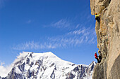 Two climbers at south wall of mount Dent du Geant, Mont Blanc in background, France, Italy