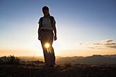 Female hiker in backlight, Andringitra Nationl Park, Madagascar