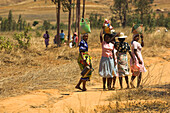 Local women, natives carrying bags on their heads, Madagascar, Africa