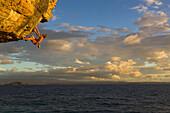 Free climber scaling rock face, Tsaranoro Be, Andringitra National Park, Madagascar