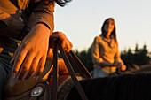 Close up of two women, horseriding, holding the reins, Muehlviertel, Upper Austria, Austria
