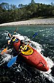 kayaker in double-kayak, Tiroler Ache, Kössen, Tyrol, Austria