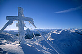 Cross with rime ice on summit of Brechhorn, Kitzbuehel range, Tyrol, Austria