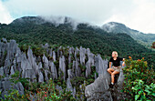 Tourist on Limestone pinnacles, Borneo, Sarawak, Gunung Mulu NP, Malaysia