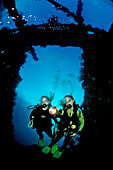 Two Scuba diver examine ship wreck Liberty, Bali, Tulamben, Indian Ocean, Indonesia