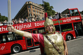 Man in Roman costume posing for tourist in front of sightseeing bus at the Colosseum, Rome, Italy
