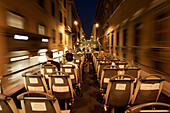 Tourists on the upper deck of a sightseeing bus at night, Rome, Italy
