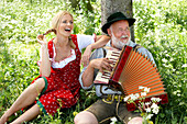 Woman listening man playing melodeon