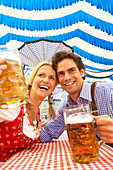 Couple with beer in a beer tent