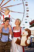 Family enjoying fun fair