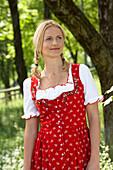 Smiling mid adult woman wearing dirndl dress