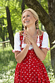 Smiling mid adult woman wearing dirndl dress