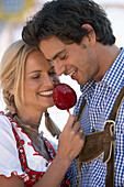 Couple eating candied apple