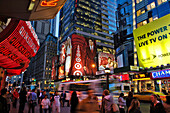 People at Times Square at night, New York City, New York, USA