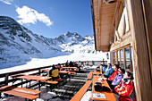 Skiers on the terrace of a mountain restaurant, alpine hut, Lazaun Upper Station, Schnalstal, South Tyrol, Italy