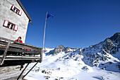 Man sitting on terrace of alpine hut Bella Vista, Schnals valley, South Tyrol, Italy