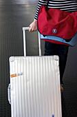 Woman with aluminium suitcase, airport, Luxemburg