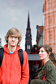Young couple in front of a window, man looking at camera, Hamburg, Germany
