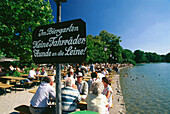 People sitting in beergarden Seehaus, English Garden, Munich, Bavaria, Germany