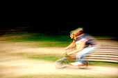 BMX rider going fast, blurred, Kaufbeuren, Bavaria, Germany