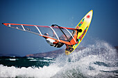 Windsurfer jumping over waves, Kos Island, Dodecanese, Greece