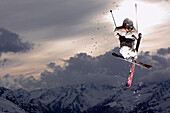 Skier jumping in the sunset, See, Tyrol, Austria