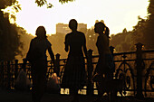 Silhouettes of three young women, Kreuzberg, Berlin, Germany