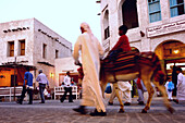 Man with child on donkey, Traditional Souk in Doha, Qatar