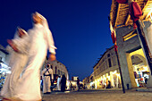 People walking through a commercial shopping area, Traditional Souk in Doha, Qatar