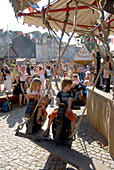 Children on a medieval merry-go-round at a festival, Luther fair, Eisenach, Germany