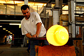Man, glass blower, worker with glowing glass, Glassworks, Lauscha, Thuringia, Germany